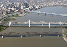 This rendering depicts one of two new Ohio River bridges – shown here across the center of the photo alongside the existing Kennedy Bridge in downtown Louisville.