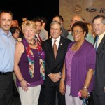 Officials at the celebration of the Louisville Assembly Plant's transformation take time for a photo with U.S. Rep John Yarmuth of Louisville.