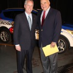 Louisville Mayor Greg Fischer and Kentucky Cabinet for Economic Development Secretary Larry Hayes are pictured in front of a Ford Escape that will be used as a pace car at the Kentucky Speedway. (Photo by Ed Lane)