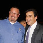Mark Fields, Ford President of The Americas, poses for a photo with Barry Ford, union official with United Auto Workers.