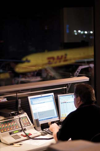 A DHL worker in the control tower at the Cincinnati/Northern Kentucky Airport, where DHL has 40 departures and 40 arrivals daily.