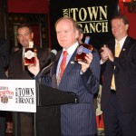 "Dr. Pearse Lyons, president of Alltech, displays two Town Branch Bourbons, the original and one called ""Title Town."""