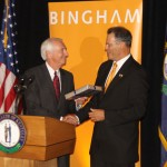 Gov. Steve Beshear presents Bingham Chaiman Jay Zimmerman a Kentucky flag.