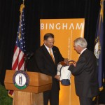 Bingham Chairman Jay Zimmerman presents Gov. Steve Beshear with a gift at Thursday's welcome ceremony.