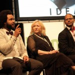 "Tahir Hemphill speaks Thursday about ""The Hip-Hop Word Count,"" his almanac of Hip-Hop lyrics at the IdeaFestival, as presenters Ruby Lerner and Hasan Elahi listen."