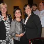 Jane Smoot White of Fowler Bell celebrates her Rising Stars award with coworkers, including Taft McKinstry, at left.