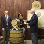 Gov. Steve Beshear prepares to hammer the bung into a commemorative barrel at the press conference announcing a new tourism adventure that links the state's micro-distilleries.