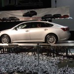The new Avalon was lowered from the ceiling along with hundreds of silver balloons, shown below the car.
