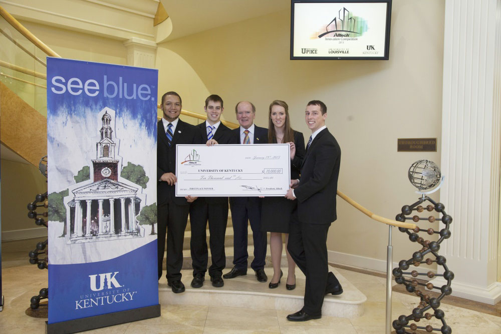 First place winners of the Alltech Innovation Competition, the University of Kentucky, are presented a check for $10,000 by Dr. Pearse Lyons, president of Alltech. Pictured from left are: Jarrod Willis, Jordan Laycock, Lyons, Lee Gage Goatley and Jordan Denny.