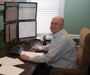 The work station of Bill Upchurch, a partner at technology-savvy Baldwin CPA in Richmond, includes a stack of four computer monitor screens and a webcam.