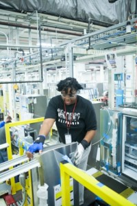 Zenobia Williams, a production employee, works on French door bottom-freezer refrigerator doors at GE in Louisville. A second shift was added last summer, creating 380 more production jobs.