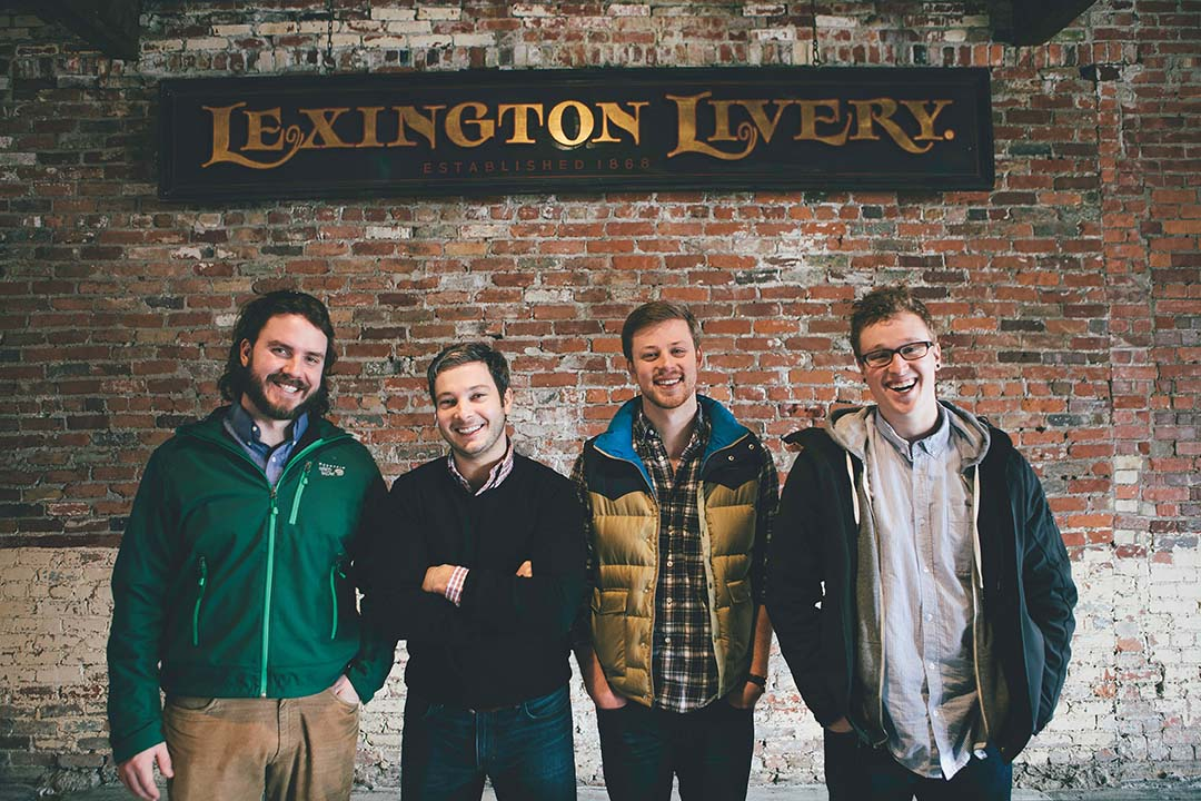 The original sign for the Lexington Livery still figures  prominently in the new decor. From left are Grant Ostrander, Bo Harris, AJ Hochhalter and Bradley Nolan.