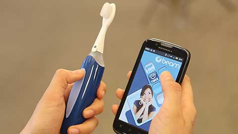 The BEAM Brush uses Bluetooth technology to communicate with a free smartphone app that summarizes performance and offers rewards for brushing at least four minutes a day.