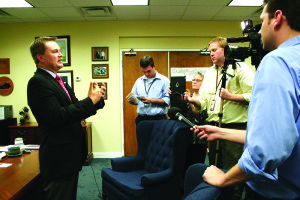 Agriculture Commissioner James Comer, left, answers questions from the news media in his Frankfort office following Thursday's meeting of the Kentucky Industrial Hemp Commission. (Kentucky Department of Agriculture photo)