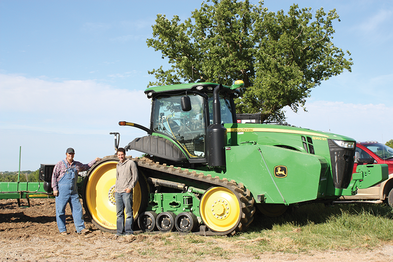 Albert Peterson of Peterson Farms and Brian Luftman of American Farm Investors with a 16-row planter.
