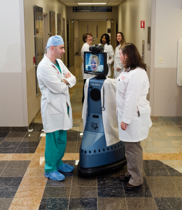 UofL's Dr. Alex Abou-Chebl, left, one of the fewer than 15 interventional neurologists in the country, talks to Dr. Kerri Remmel, on display screen, director of University (of Louisville) Hospital's Stroke Center, via an In Touch medical robot.