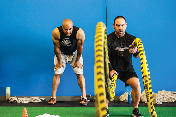 Creating a wavelike pattern with a heavy rope works every major muscle group in the body and strengthens the core.