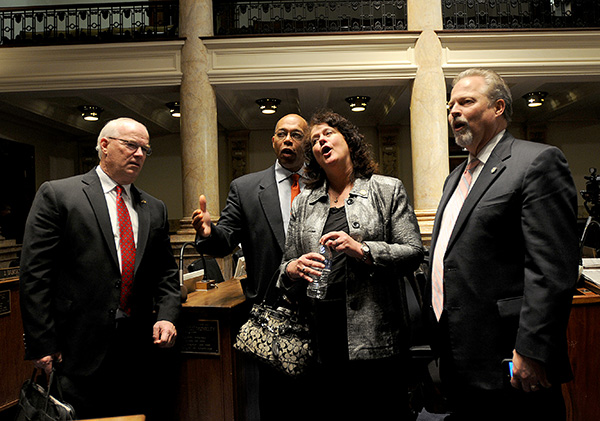 "From left, Sen. Dennis Parrett, D-Elizabethtown, Sen. Reginald Thomas, D-Lexington, Sen. Alice Forgy Kerry, R-Lexington, and Sen. Mike Wilson, R-Bowling Green, sing ""My Old Kentucky Home"" in the Kentucky Senate after the midnight final adjournment of the 2014 Regular Session of the Kentucky General Assembly."