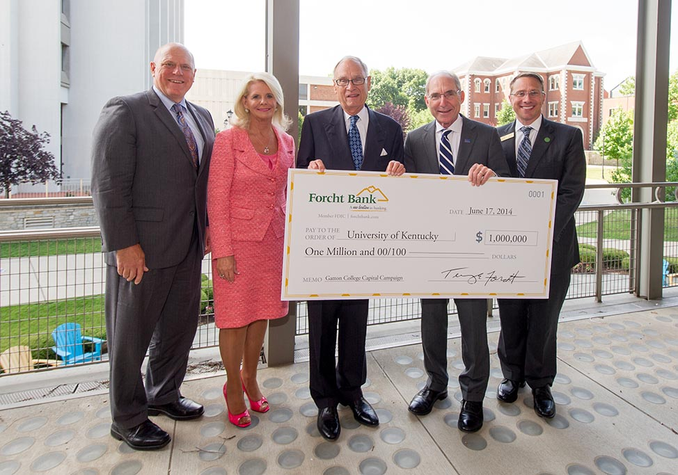 From left, David W. Blackwell, dean of UK's Gatton College of Business & Economics; Debbie Reynolds, president of Forcht Group; Terry Forcht, Chairman of Forcht Bank and Forcht Group of Kentucky; Eli Capilouto, president of the University of Kentucky; and Tucker Ballinger, president of Forcht Bank.