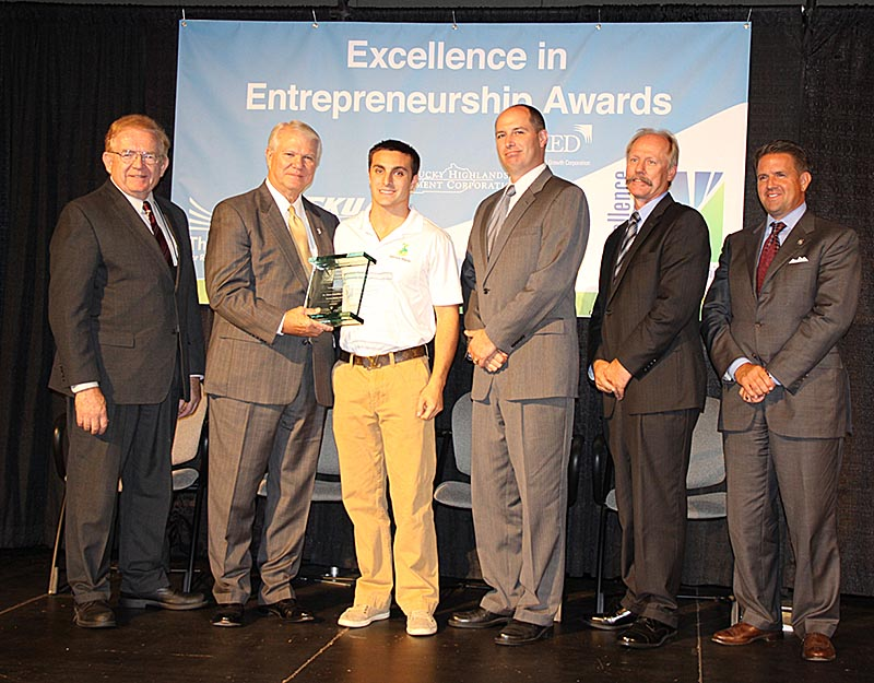 Shane Hamilton, third from left, owner Service Maids Inc. Garrett, Ky., was named the EIEA 2014 Young Entrepreneur; with him are, from left, Thomas Erekson, dean of the EKU College of Business and Technology; Ray Moncrief, executive vice president of Kentucky Highlands Investment Corp; Brett Traver, executive director of Southeast Kentucky Economic Development; Lonnie Lawson, president/CEO of The Center For Rural Development; and Michael Benson, president of EKU.