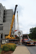 Workers unload a magnetic resonance imaging unit that was installed at Baptist Health Louisville hospital in August 2014.