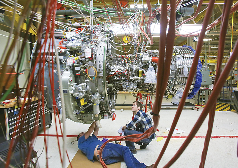 Engineers work on a more fuel efficient LEAP commercial jet test engine for GE Aviation. Kentucky suppliers provide parts for the engine, which is being made by CFM, a joint venture between GE and French manufacturer Snecma.