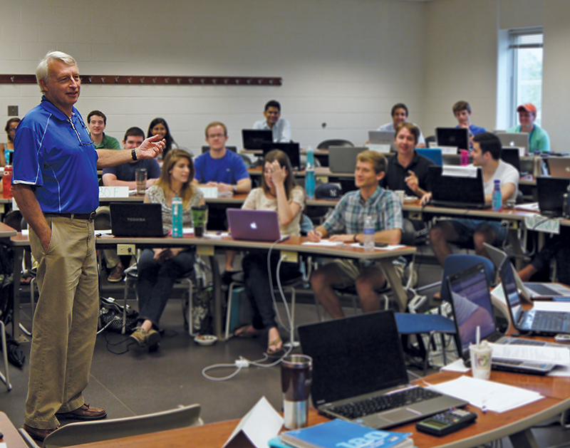 Professor Frank Scott, a faculty member in the University of Kentucky Accelerated One-Year MBA Program, addresses a traditional classroom of students.