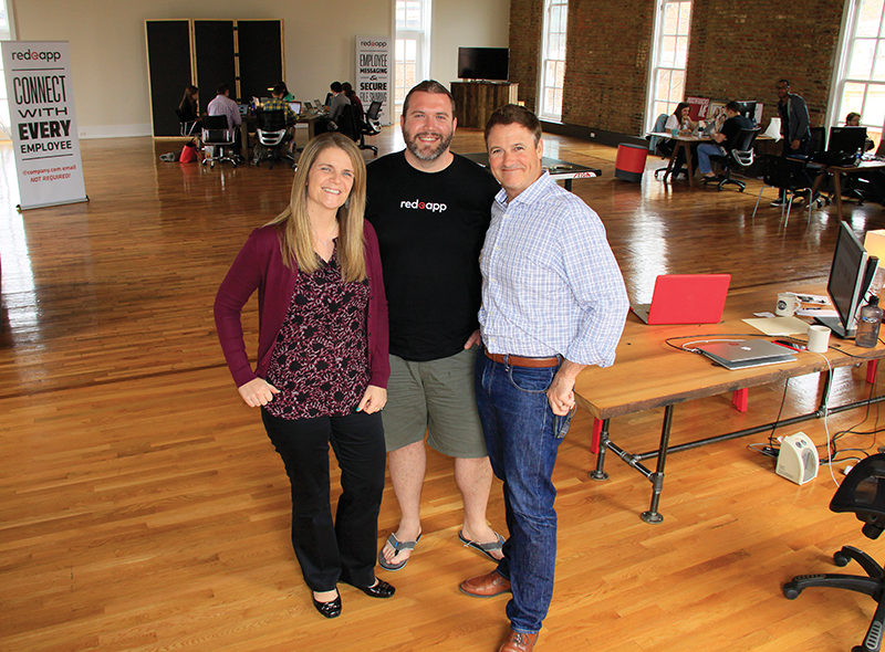 Red e App, a four-year-old Louisville tech company, has developed a private business communication product that operates via employees' mobile devices. Amee Kent, marketing director, Patrick Goodman, chief product officer, and Jonathan Erwin, founder and CEO, and another 15 employees for Red e App work from a renovated building in the NuLu district near downtown.