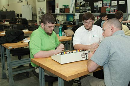 Student workers in the KY FAME program spend two days a week in the classroom and three days a week at paid jobs with participating manufacturer partners, who help develop 18-month curriculums that lead to an associate's degree and a full-time job.