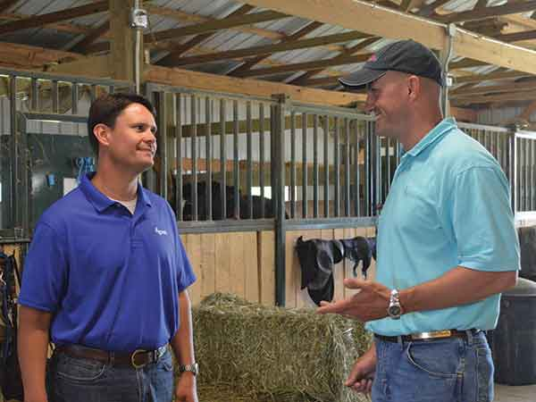 John Peek, left, loan officer at the Stanford branch of Ag Credit, speaks with Patrick Higginbotham of Fayette County about Higginbotham's horse boarding operation.