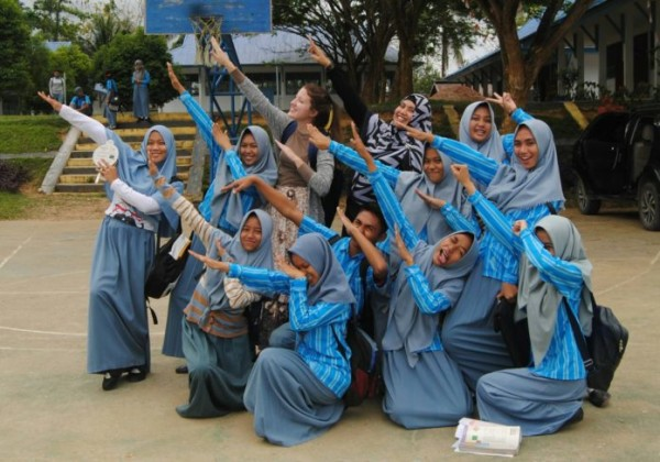 Shelby Lawson, center, had some fun with new friends in Indonesia.