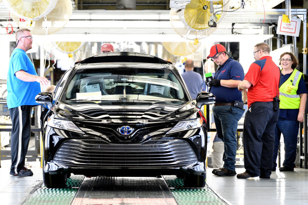 Team members inspected one of the first 2018 Toyota Camrys produced in Georgetown, Ky.