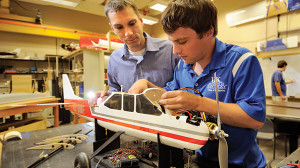 Dr. Sean Bailey, left, associate professor in the Department of Mechanical Engineering at the University of Kentucky, focuses on directing research with a student who is studying aeronautical engineering.
