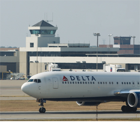 A Delta Air Lines jet lands at Cincinnati/ Northern Kentucky International Airport in this March 2012 file photo.