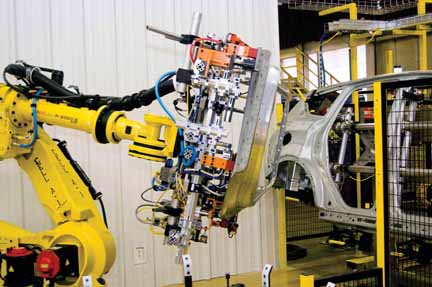 Robotic equipment is used to build the 2013 Ford Escape. It was installed last year at the Louisville Assembly Plant as part of a factory redesign.