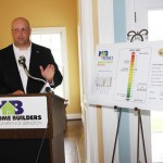Todd Johnson, executive vice president of the Home Builders Association of Lexington, announces that the association has committed to having all of its builders have their homes energy rated. The builders also will market their homes' HERS Index score.