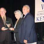 Representatives from Eminence Speaker LLC accept the Martha Layne Collins International Trade Award from Collins during Kentucky World Trade Day in Lexington.