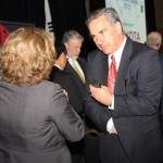 J. Edwin Webb, president and CEO of World Trade Center Kentucky, speaks with a colleague Monday at the conclusion of Kentucky World Trade Day.