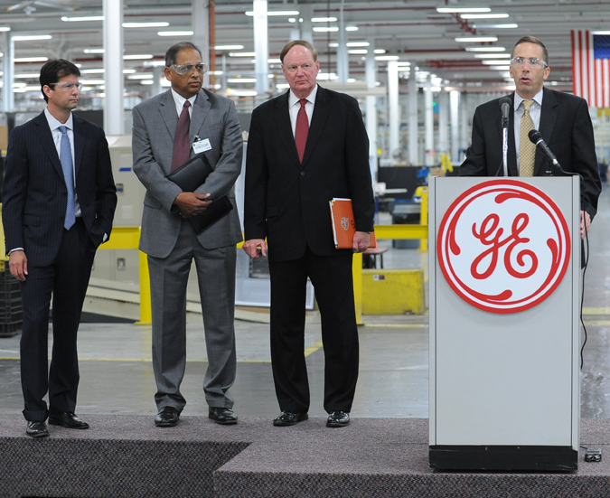 In this file photo, the University of Louisville and GE officials make a partnership announcement at Appliance Park. GE invested $650 million and created 364 jobs as part of an expansion at Appliance Park announced last year.