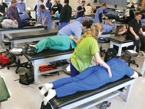 Students at Pikeville College School of Osteopathic Medicine work on their manipulation therapy technique with each other in class in November.