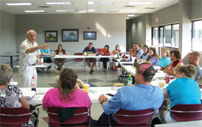 Dr. Stephen Wilson leads a class discussion in a Bardstown associate class that was taking place at a local industry.