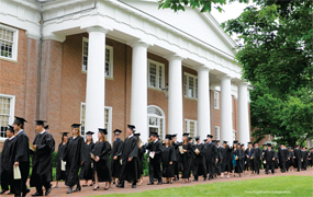 Centre students traditionally line up for Commencement in front of Old Centre, the college's original building, completed in 1820.