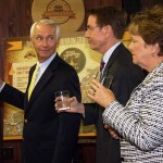 Gov. Steve Beshear, Lexington Mayor Jim Gray and Tourism, Arts and Heritage Secretary Marcheta Sparrow prepare to toast to the new Kentucky Bourbon Trail Craft Tour.