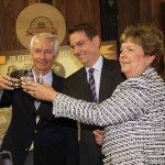Gov. Steve Beshear, Lexington Mayor Jim Gray and Tourism, Arts and Heritage Secretary Marcheta Sparrow toast to the new Kentucky Bourbon Trail Craft Tour.