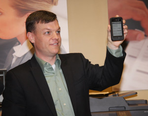 Brian Henderson, Lexmark's Director of Worldwide Product Marketing, demonstrates the compatibility of the company's newest multifunction products with mobile devices. Perceptive Mobile allows users to participate in business processes, view and interact with content, updates cases and make decisions using a Windows 8 device from virtually anywhere.