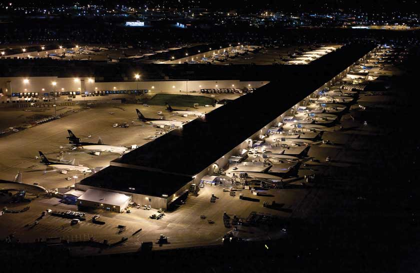 A very active UPS Worldport in Louisville lights up the night. In 2012, UPS Airlines, which represents 57 percent of UPS's carbon footprint, reduced its fuel use and carbon production. Air shipping volume rose 4.8 percent year over year, while fuel use dropped 1.3 percent.