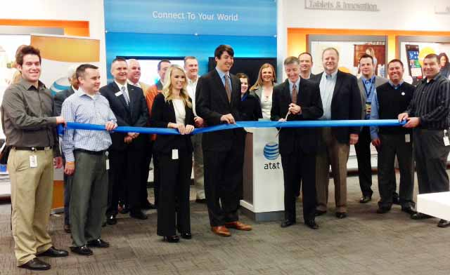 AT&T officials cut a ribbon to celebrate the launch of its 4G LTE network in Lexington.