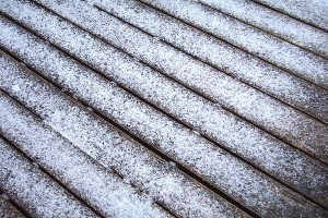 From a distance, sleet may look like snow on a road, but is more granular, similar to gravel and sand.