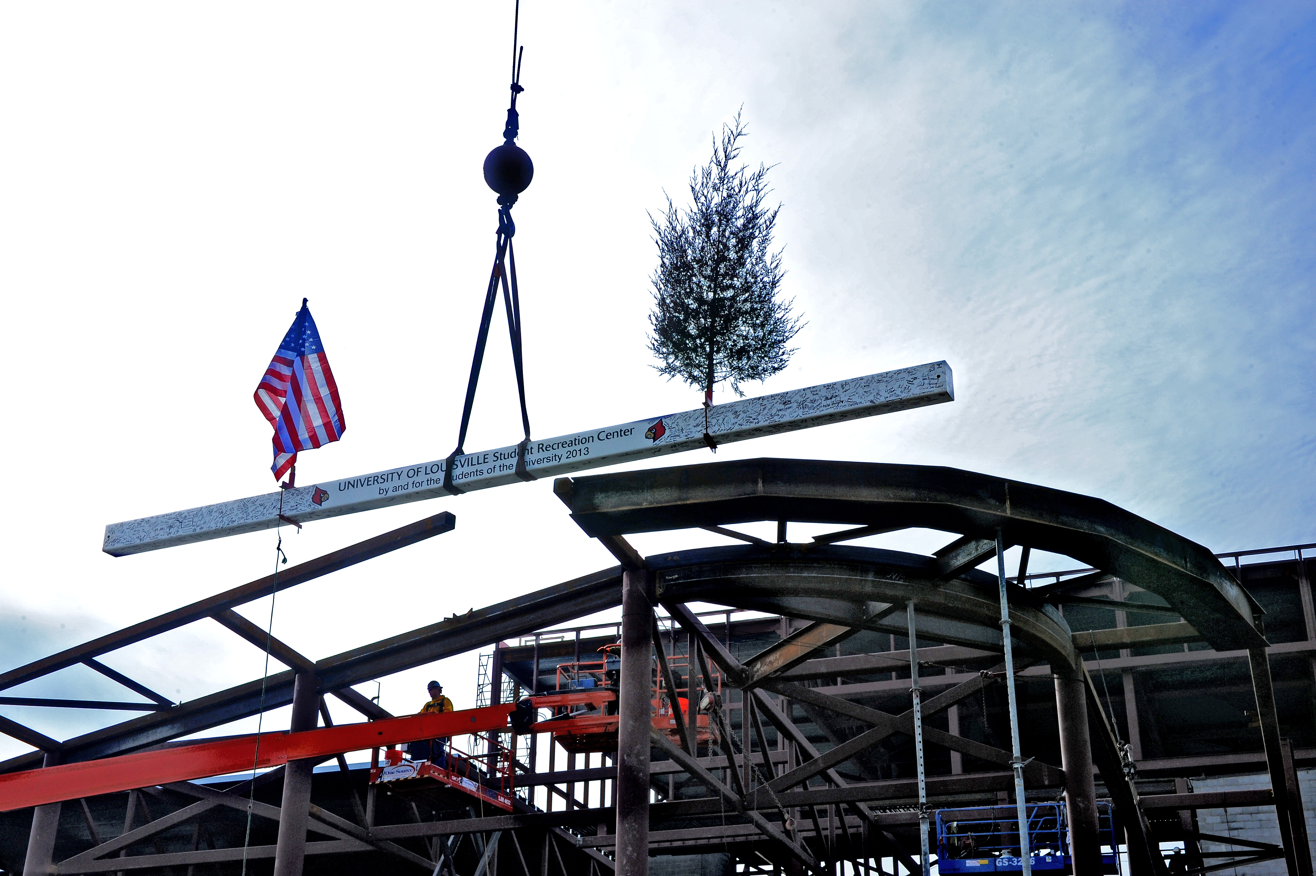 The final top steel beam goes into place Tuesday on the University of Louisville Belknap Campus for a $37.5 million student rec center expected to open in the fall.