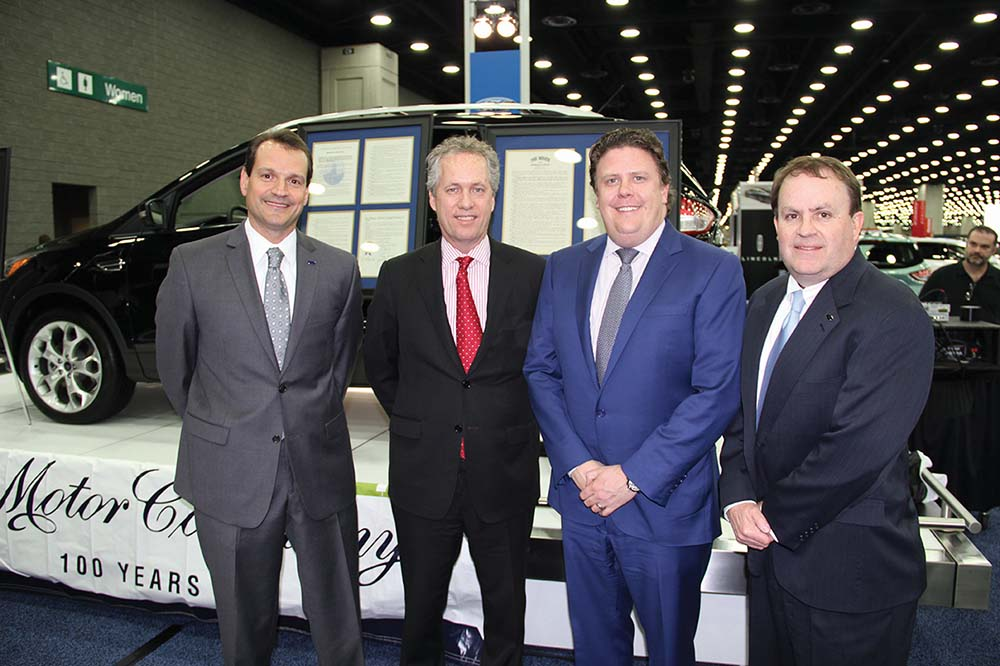 John Savona, manager of the Louisville Assembly Plant, marks the 100th anniversary of Ford's Louisville operations, along with Mayor Greg Fischer, John Paul Miller Jr. of Paul Miller Ford, and Kentucky Truck Plant Manager Joseph Bobnar.
